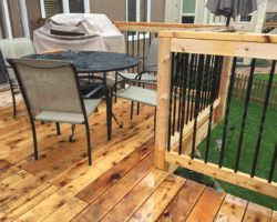 cedar wood deck with spindles built by Omaha's Year-Round Deck Company